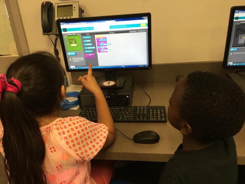 Dalia and Malachi explore coding together.