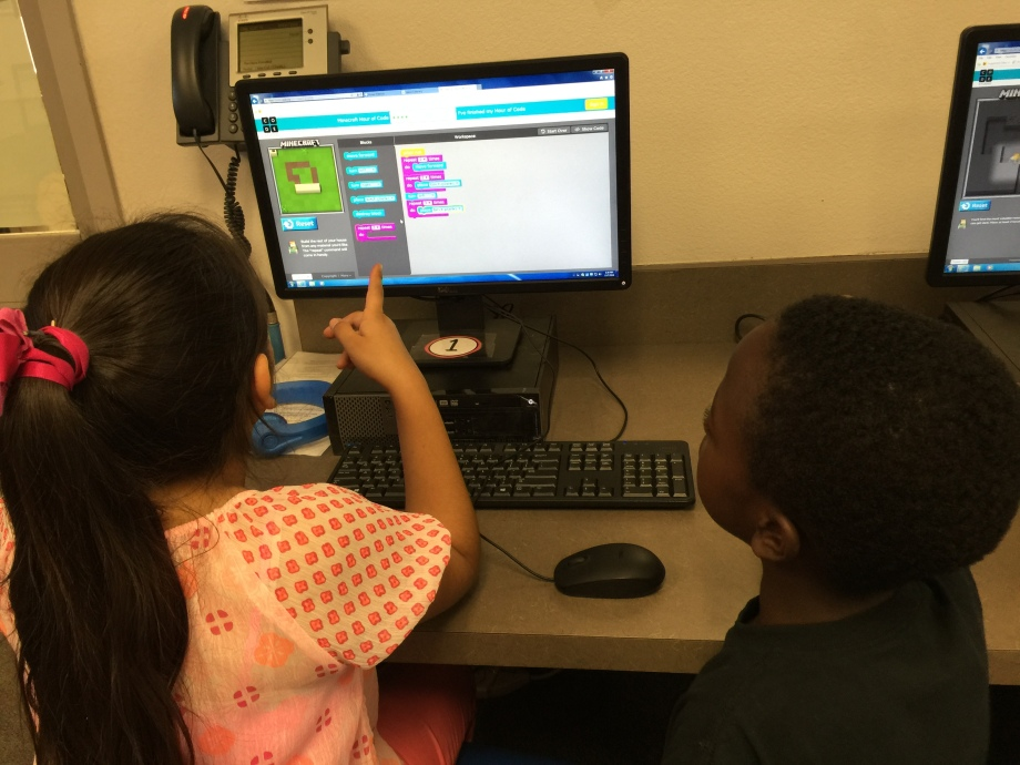 Dalia and Malachi explore coding together.